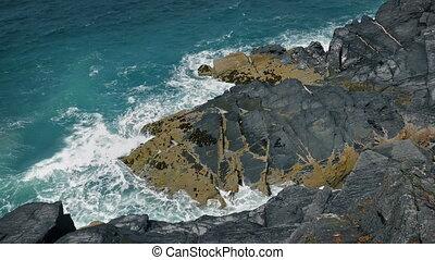 Waves Breaking Over Big Rocks Coastal Landscape