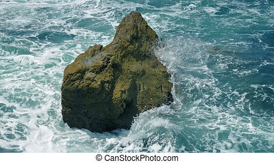 Waves Breaking Over Rock In The Sea