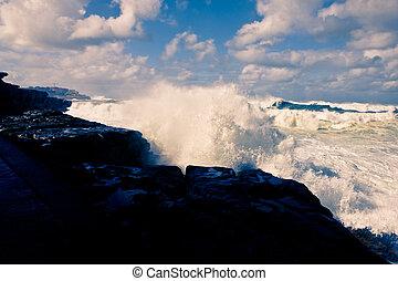 Waves crashing ashore during a cyclone