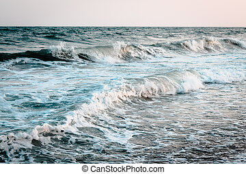 Waves crashing in on the beach