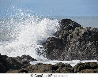 waves crashing into rock - crashing waves in Montezuma, ...