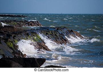 Waves Crashing into Rocky Shoreline