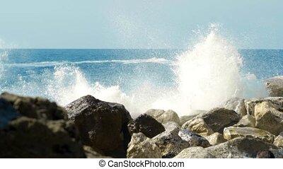 waves crashing on rocks and rocks, slow motion