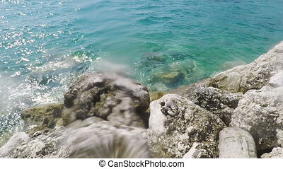 Waves crashing on rocks on Adriatic Sea shore - Waves...