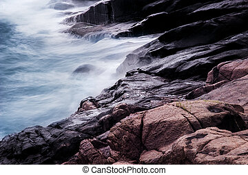 Waves crashing on rocks.