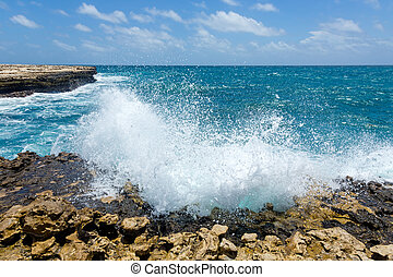 Waves Crashing on Rocky Coastline