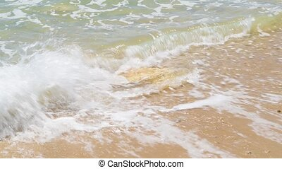 Waves crashing on the sandy beach - Soft blue ocean waves...
