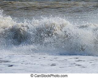 Waves Crashing onshore - North Sea waves crashing onshore at...