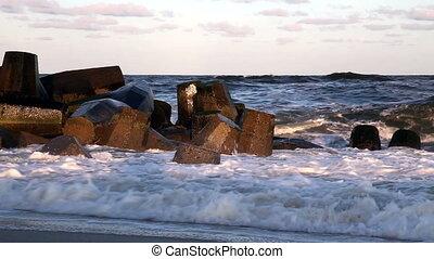 Waves Crashing onto Jetty in Ocean