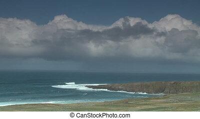Waves Crashing Onto Peninsula - Steady, extreme wide shot of...
