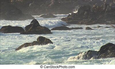Waves Crashing Onto Seal LS - LS crashing into rocks on...