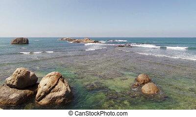 waves crashing over rocks