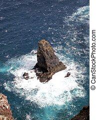 Waves crushing into the rocks at sea