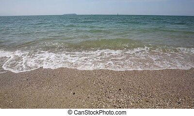 waves ebbing and flowing - motion of waves ebbing and...