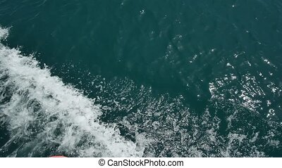 Waves from the boat on the water. Bay of Kotor, Montenegro, the