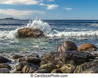 Waves hitting rock in Norway