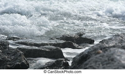 waves hitting the cliffs slow motio