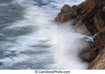 Waves hitting the rocks