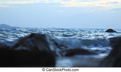Waves hitting the sea shore on Samui island