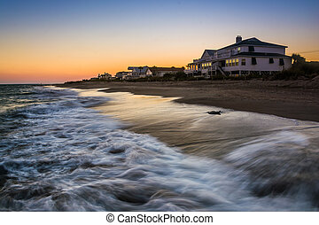 Waves in the Atlantic Ocean and beachfront homes at sunset, Edis