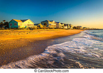 Waves in the Atlantic Ocean and morning light on beachfront homes at Edisto Beach, South Carolina.
