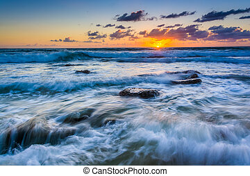Waves in the Pacific Ocean at sunset, in Laguna Beach, Californi