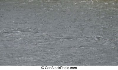 Waves in the river. Restless water in the river because of the strong wind