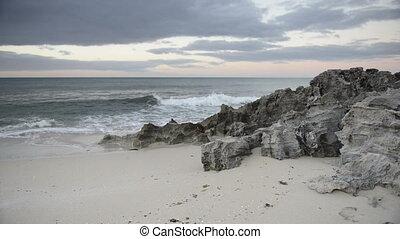 Waves Lapping Beach at Dusk