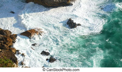 Waves ocean cliffs rocks - Waves of the ocean hitting the...