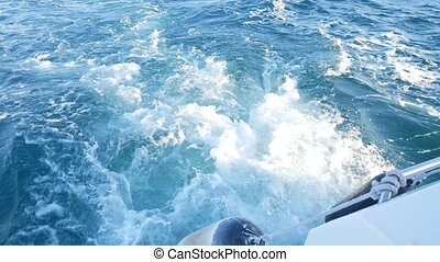 waves of blue sea water, while the boat is moving fast. 4k,...