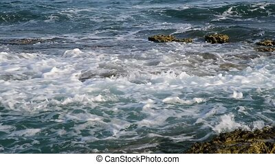 Waves of Mediterranean Sea near the rocky shore