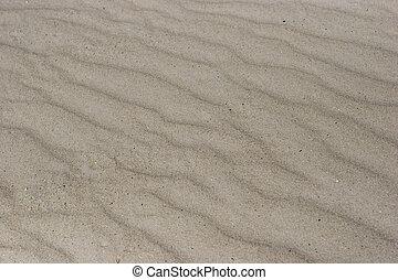 waves of sand , on a beach