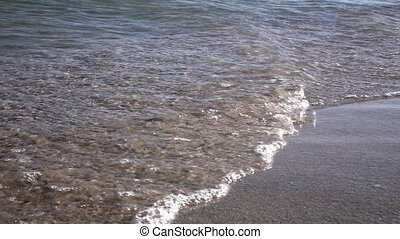 Waves of the beach. Slow motion. Close up
