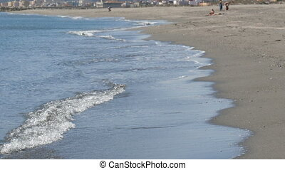 Waves of the Mediterranean Sea are washed by sandy shore...