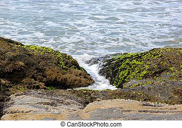 Waves of the sea between rocks