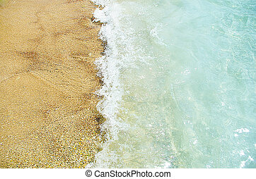 waves of the sea in the beach with a sand