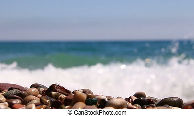 waves of the sea on pebble beach