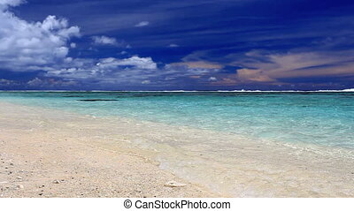Waves on a deserted tropical beach