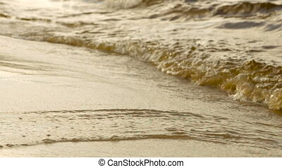 Waves on a sandy beach
