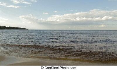 Waves on a sandy beach