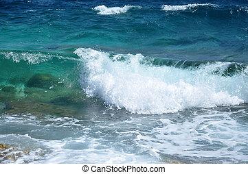Waves on a shoreline - Waves crushing the shoreline, ...