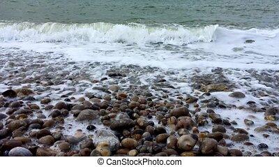 Waves on a stone beach