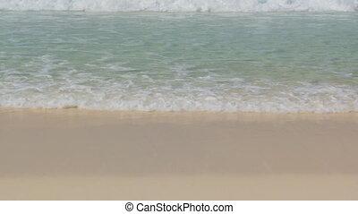 waves on beach closeup