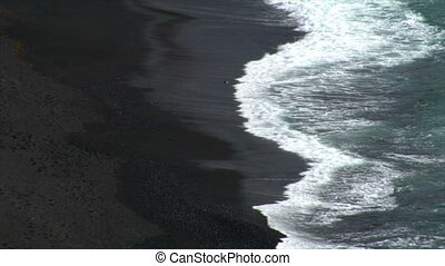 waves on black lava beach backgroun
