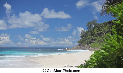 whitecaps rushing on sandy beach