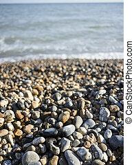 Waves on pebble beach.