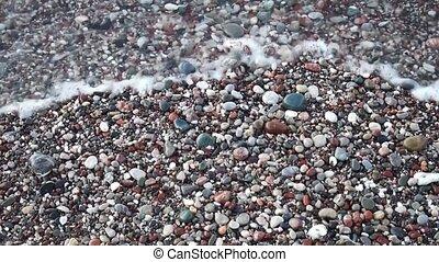Waves on pebble