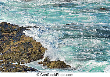 waves on rocks