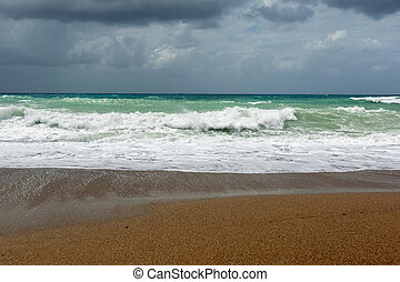 Waves On sand beach of the Aegean Sea in Rhodes.