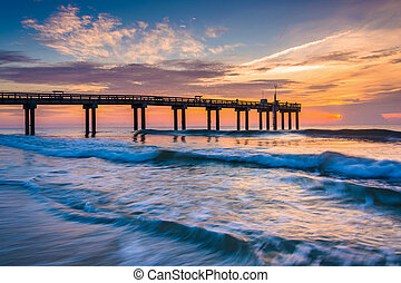 Waves on the Atlantic Ocean and fishing pier at sunrise, St. Aug